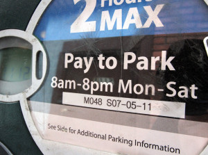 The parking meter near the entrance to the Sea Garden Restaurant  shows the enforcement hours are from 8 a.m. to 8 p.m. [Greg Gilbert, The Seattle Times.]