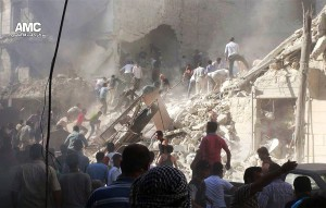 In this image provided by Aleppo Media Center AMC, which has been authenticated based on its contents and other AP reporting, Syrians inspect the rubble of damaged buildings due to heavy shelling by Syrian government forces in Aleppo, Syria, Monday. (AP Photo/Aleppo Media Center AMC)