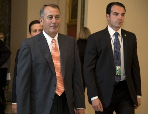 House Speaker John Boehner of Ohio walks vote on the House floor on Capitol Hill, Sept. 19, 2013 in Washington. House Republican leaders scrambled Thursday to line up support in advance of a late-afternoon vote on legislation that would cut nearly $4 billion a year from the food stamp program. [AP Photo/Carolyn Kaster]