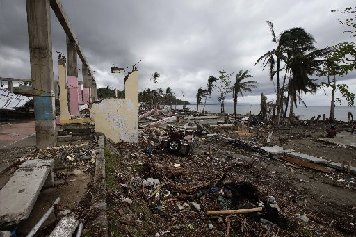 Debris still litters the coastal township of Basey Thursday, Nov. 28, 2013, nearly three weeks after Typhoon Haiyan lashed Eastern Samar province in central Philippines. (AP Photo/Bullit Marquez)
