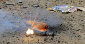 With a loud report, this fireworks explodes after being lit amid spent items at the Muckleshoot Indian Tribe's site in Auburn. (PHOTO BY ALAN BERNER/THE SEATTLE TIMES)
