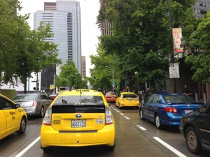 Taxis protest the lack of regulation for services like Uber and Lyft in Seattle on Aug. 2, 2013. (Genevieve Alvarez / The Seattle Times)