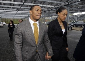 Football player Ray Rice holds hands with his wife, Janay, as they arrive at Atlantic County Criminal Courthouse in Mays Landing, N.J. The pair have become icons for domestic violence awareness.