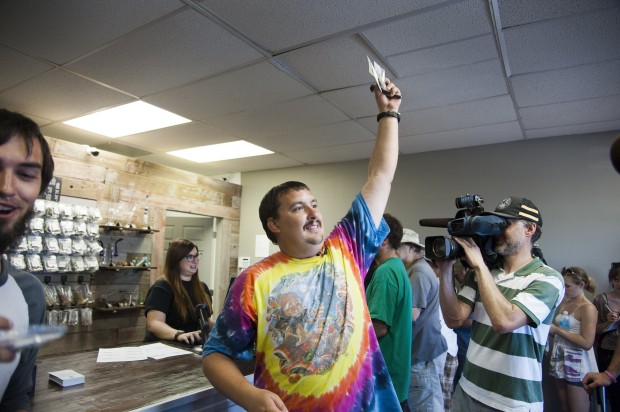 Mark Boyer becoming the first man in Spokane to purchase pot from a retail shop. (Photo by Dan Pelle, The Spokesman-Review / Associated Press)