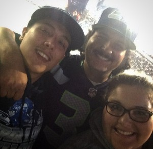 Lilly Cox, right, and her brothers show their spirit at a Seahawks game.  Photo courtesy of Lilly Cox