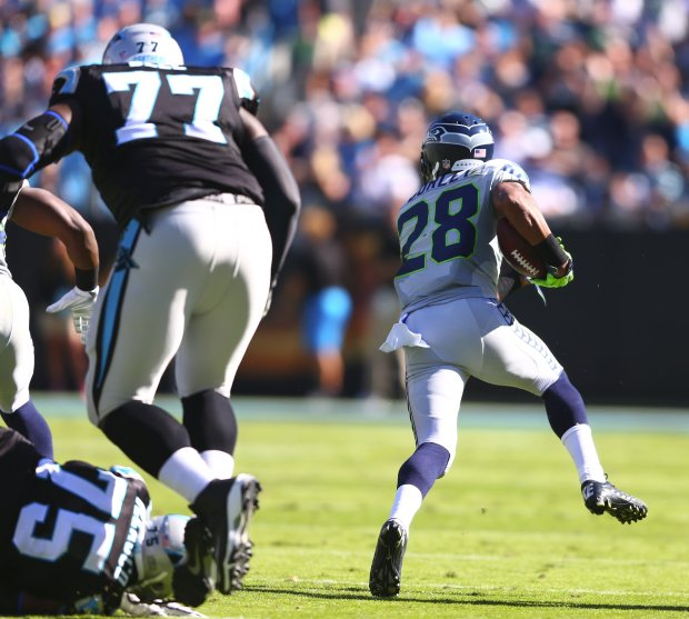 Seattle Seahawks cornerback Marcus Burley takes his interception upfield against the Carolina Panthers in the second half on Sunday at Bank of America Stadium in Charlotte, North Carolina. (Photo by John Lok / The Seattle Times)