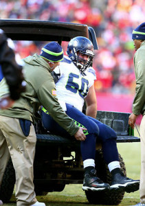 Seattle Seahawks center Max Unger is loaded on to a cart after he was injured in a play against the Kansas City Chiefs in the fourth quarter. (Photo by John Lok / The Seattle Times)