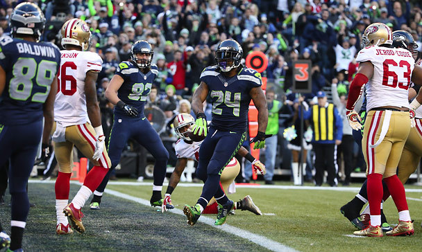 Seahawks running back Marshawn Lynch trots into the end zone for a 4-yard touchdown during the third quarter. (Photo by Bettina Hansen / The Seattle Times)