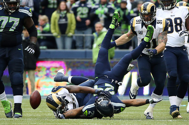 Under pressure from Rams linebacker Alec Ogletree, Seahawks running back Marshawn Lynch fumbles the ball during the second quarter. It is then recovered by the Rams. (Photo by Bettina Hansen / The Seattle Times)