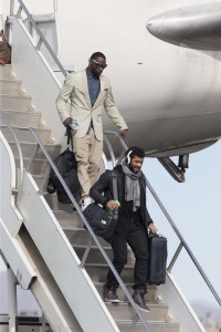 Russell Wilson and his Seahawks teammates deplane in Phoenix. (Dean Rutz / The Seattle Times)