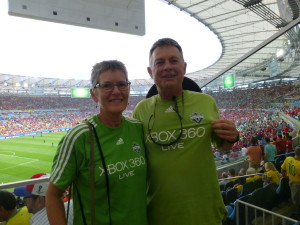 Bruce Jones and his wife Melinda proudly wear their Sounders jerseys at the Chile-Spain match. (Photo courtesy of Bruce Jones)