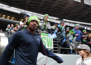 Seahawks running back Marshawn Lynch takes the field to warm up before the final regular-season game against the Rams at CenturyLink Field.  Bettina Hansen / Seattle Times staff
