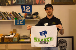 "Travis Benton, general manager of Gold and Silver Pawn featured on History Channel's ""Pawn Stars"" TV show, displays a Seahawks NFC Championship towel.  Photo by Kimberly De La Cruz"