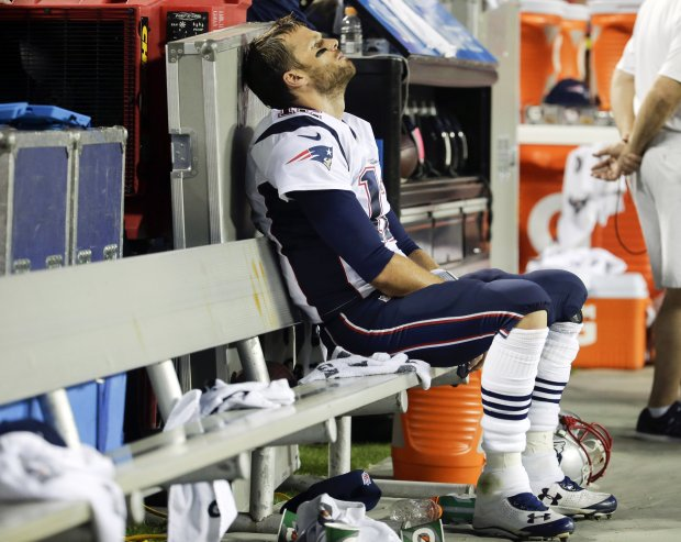 Patriots quarterback Tom Brady sits on the bench during the fourth quarter of the loss to Kansas City this season. Charlie Riedel / The Associated Press