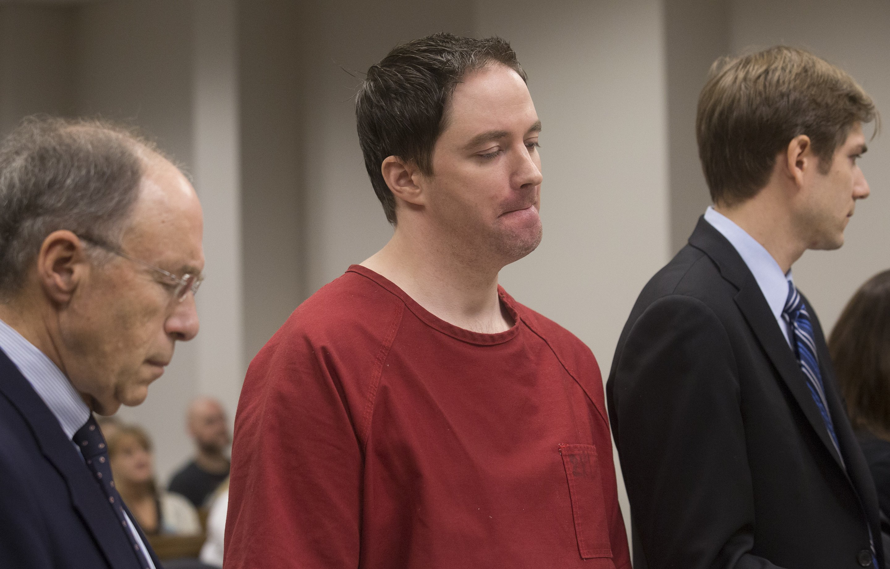 "Martin ""David"" Pietz is flanked by defense attorneys David Allen, left, and Cooper Offenbecher during his sentencing this morning. (Photo by Ellen M. Banner / The Seattle Times)"