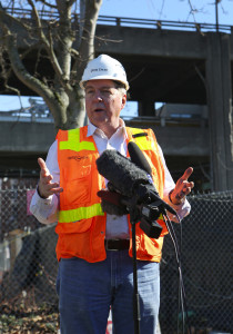 Chris Dixon, project director for Seattle Tunnel Partners, talks during a news conference Friday. The old Alaskan Way Viaduct is seen in the background.  (Ken Lambert / The Seattle Times)
