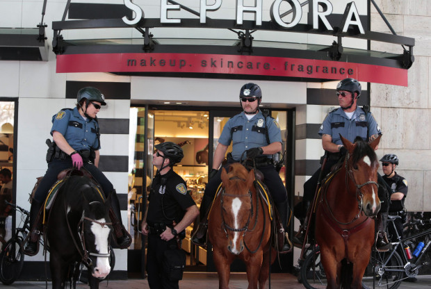 Seattle Police sit on horses in front of Sephora, at Westlake Park around noon. (Photo by Mike Siegel / The Seattle Times)