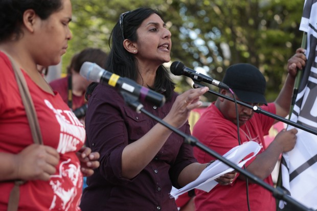 Kshama Sawant talks to the crowd just after 5:30pm after the 14th annual May Day March for Workers and Immigrant Rights arrived in Westlake Park
