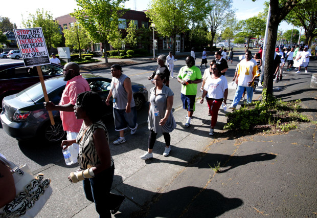 "A crowd marches in the Central District during the ""Heal the Hood"" march. (Photo by Dean Rutz / The Seattle Times)"