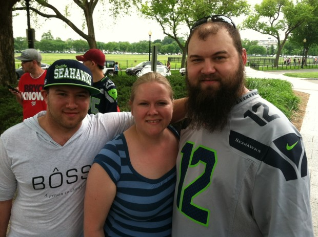 "Serj Chudak,, 33, a Seattle remodeler, his wife Diana, 31, and Oleg Chudak, 25, who is in he U.S. Army. The family had flown from Seattle to the nation's capitol for a graduation of a friend, but stayed on in the hope of catching the Seahawks. They also failed to get a glimps of the plaeyre. But, said Serj Chudak, ""Even if I don't see them, the slight presence of them is what counts."""