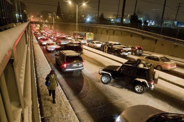 Traffic inches along Mercer Street headed for I-5 on Nov. 22, 2010. Sometimes the smartest thing a person could do was just give up on motor transportation and hoof it.  (Dean Rutz / The Seattle Times)