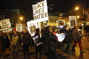 Roughly 100 people gathered at Westlake Park in downtown Seattle as the Ferguson, Mo. grand jury decision was announced. (Credit: Mark Harrison / The Seattle Times)