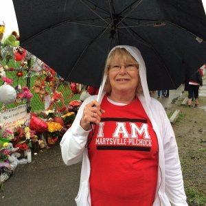 Joanne Coty, a grandmother of Marysville-Pilchuck student, wears her red and white T-shirt in support of the school. (Jack Broom / The Seattle Times)