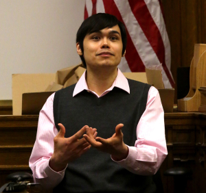 "Thomasdinh ""Dinh"" Bowman, 31, takes the stand in his defense. He is charged with first-degree murder in the 2012 shooting death of Yancy Noll. (Photo by Greg Gilbert / The Seattle Times)"