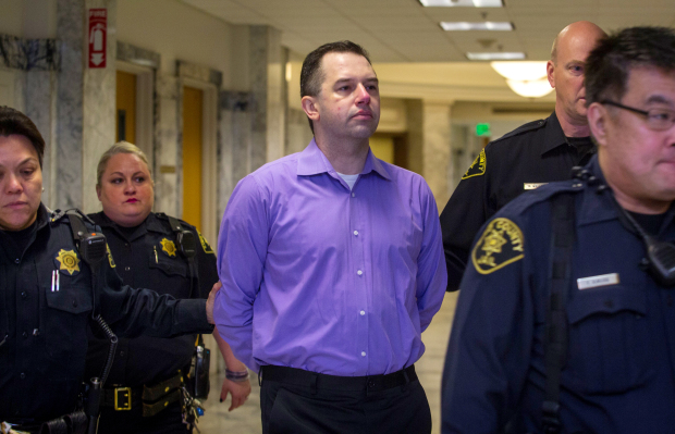 Joseph McEnroe walks into court Tuesday morning before the start of his trial. (Ellen M. Banner / The Seattle Times)