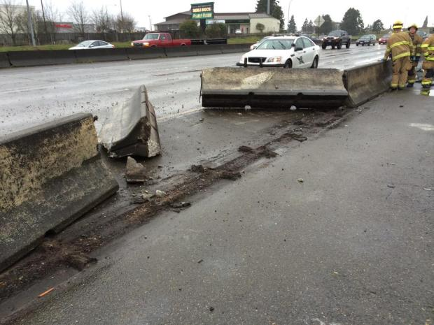 A pick-up truck hit the barrier on I-5 in Tacoma. (Washington State Patrol photo)