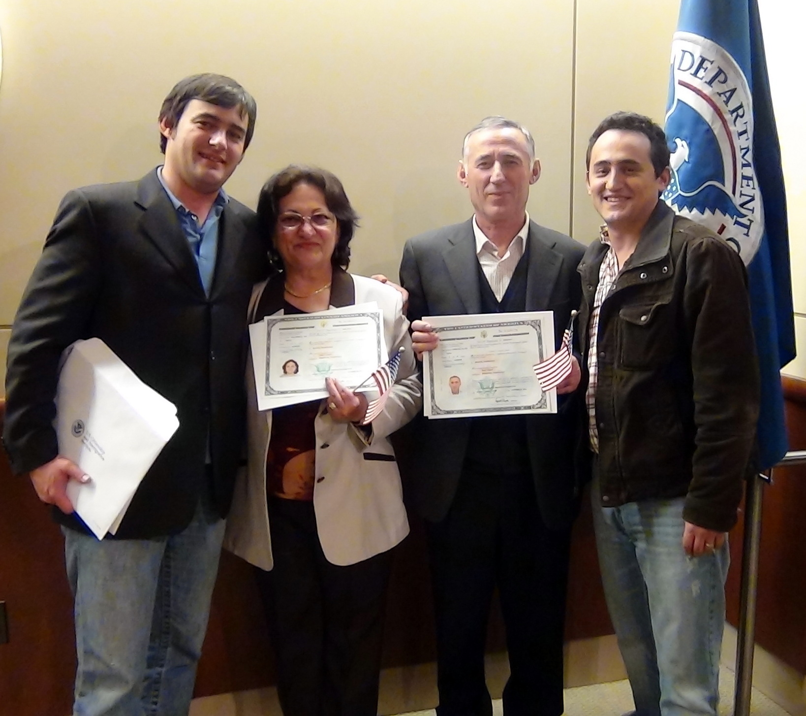 Merita and Naim Hyseni were sworn in as United States citizens on October 27, 2011. Pictured with their sons Oltion (left) and Julian (right).