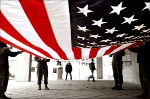U.S. flag being readied for folding on Flag Day